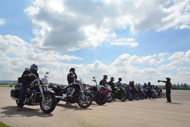 Motorcyclists at Storck Barracks, U.S. Army Garrison Ansbach, line up on the tarmac after completing a motorcycle refresher course and before riding to Geiselwind, Germany, as a part of a group ride to promote motorcycle safety June 7.