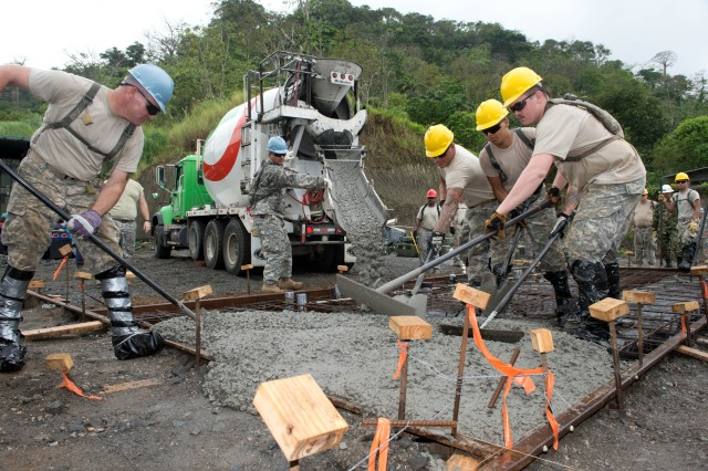 Soldiers from the 284th Engineer Company, based in Seagoville, Texas, spread concrete for a foundation of a clinic in Achiote, Panama, during the Beyond the Horizon exercise, April 17, 2013. Beyond the Horizon is a U.S. Southern Command-sponsored, U.S. Army South-planned and -led annual humanitarian and civic assistance exercise that provides construction and medical assistance to partner nations throughout Central and South America and the Caribbean. (U.S. Army photo by Kaye Richey, U.S. Army South Visual Information)