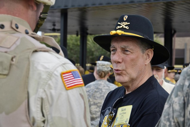 Ken White, a 1st Cavalry Division Association member and former trooper with the division 1966 to 1968, talks with period-dressed soldiers June 7 about his time with the 1st Cav at the division headquarters Cooper Field at Fort Hood, Texas.