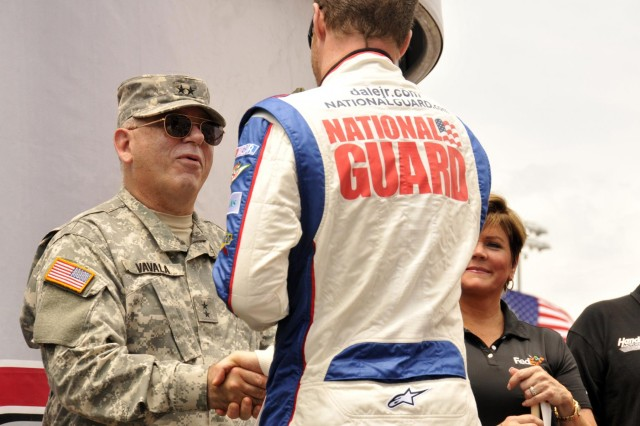 U.S. Army Maj. Gen. Francis D. Vavala, the adjutant general of the Delaware National Guard, shakes hands with race car driver Dale Earnhardt, Jr. during the opening ceremony for NASCAR's FedEx 400 at the Dover International Speedway in Dover, Del., June 2, 2013. (U.S. Army National Guard photo by Staff Sgt. Brendan Mackie/Released)