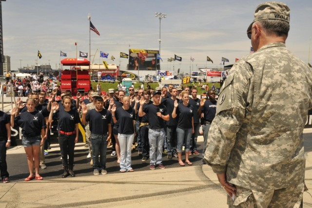 U.S. Army Maj. Gen. Francis D. Vavala, the adjutant general of the Delaware National Guard, administers the oath of enlistment to enlistees of the active Air Force, Delaware Air National Guard and Delaware Army National Guard, during a ceremony at the Dover International Speedway in Dover, Del., June 2, 2013. (U.S. Army photo by Staff Sgt. Brendan Mackie/Released)