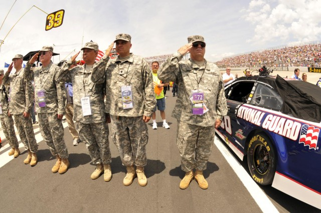 U.S. Army Maj. Gen. Francis D. Vavala, right, the adjutant general of the Delaware National Guard, salutes during the playing of the National Anthem at the start of NASCAR's FedEx 400 at the Dover International Speedway, in Dover, Del., June 2, 2013. (U.S. Army National Guard photo by Staff Sgt. Brendan Mackie/Released)