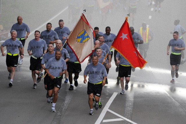 KAISERSLAUTERN, Germany - Maj. Gen. Aundre F. Piggee, left, and Command Sgt. Maj. Michael A. Sanchez, right, the 21st Theater Sustainment Command's commanding general and command sergeant major, respectively, lead the 'First in Support' command team on an 'esprit de corps' run to celebrate the U.S. Army's 238th birthday on Rhine Ordnance Barracks, June 13. The run marked the first celebratory event of the day. (Photo by Staff Sgt. Alexander Burnett, 21st TSC Public Affairs)