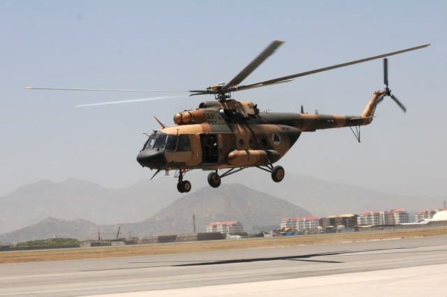 An Afghan Mi-17 helicopter flown by Lt. Col. Bakhtullah, 377th Afghan Air Force Squadron commander, takes off for an air-assault training flight, May 29 from Kabul International Airport, Afghanistan. Bakhtullah and the squadron's standardization officer, Maj. Farid, are participating in an air-assault planning certification course mentored by 10th Combat Aviation Brigade advisers in preparation to begin instructing their aviators in air mission planning procedures.