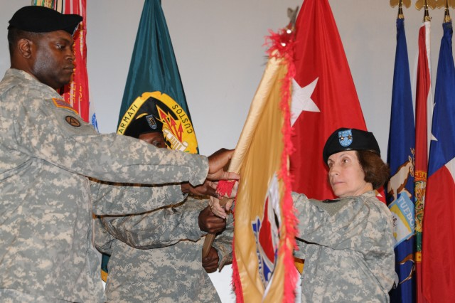 Col. Antonio Brown unfurls the brigade colors with Maj. Gen. Camille M. Nichols during an activation and assumption of command ceremony June 7 at Fort Bragg, N.C.