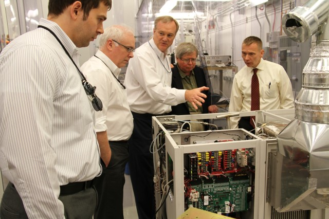 CERDEC CP&I hosts defense partners for a demo of the Solid Oxide Fuel Cell 10 kW power unit. (From left to right:  Zackery Dunbar, ARL; John Jennings, OSD; Don Hoffman, ONR; Dr. Jack Taylor, OSD; Dr. John Pazik, OSD)