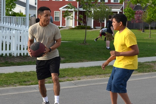 Sgt. 1st Class Allan Welchez, a chief food management NCO assigned to 10th Sustainment Brigade, plays basketball with a student from the Watertown Big Brothers, Big Sisters of America. He often finds a child in need of a mentor to give back to the community and help the youth have a better chance at a brighter future.