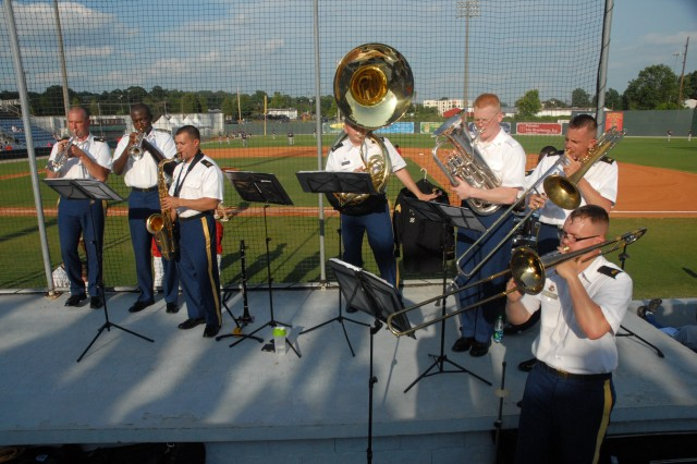 Soldiers with the 282nd Army Band entertain the crowd before the game.