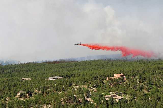 "BLACK FOREST, COLO. "" An aircraft releases a fire-retardant solution to help stop the spreading of the burning fires at Black Forest, Colo., June 12, 2013. (Photo by Sgt. Jonathan C. Thibault, 4th Combat Aviation Brigade Public Affairs Office, 4th Infantry Division/Released)"
