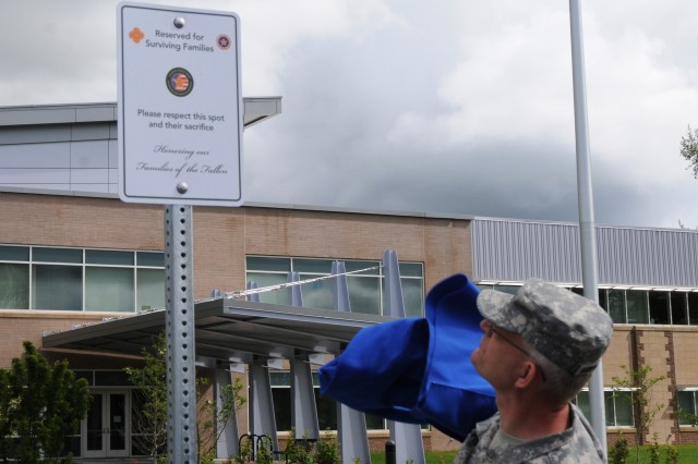 Col. John Worthington, support operations officer with the 364th Expeditionary Sustainment Command, unveils the unit's new Gold Star Families parking space.