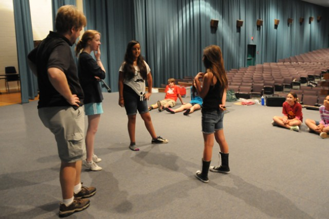 Children work on their memory and observation skills during a theatrical workshop June 11 at the post theater with the traveling directors and actors of the Missoula Children's Theatre.