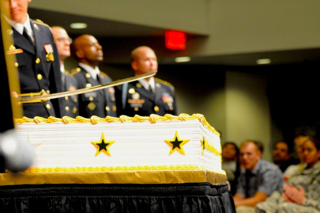 Senior defense leaders and Soldiers cut a birthday cake, June 13, 2013, at the Pentagon, as part of the Army's 238th birthday celebration.
