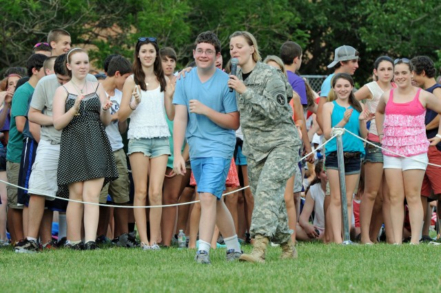 "A member of the Army Band ""Downrange"" sings to a teen during a Twilight Tattoo ceremony recognizing the 238th Army Birthday, which is June 14, 2013. The tattoo was held at Joint Base Myer-Henderson Hall, Arlington, Va., June 12, 2013."