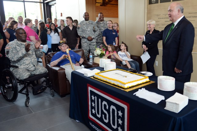 Under Secretary of the Army Joseph W. Westphal speaks to the crowd at the Army birthday cake-cutting at the USO on Fort Belvoir, Va., June 13, 2013, with the commander of Fort Belvoir, Col. Gregory Gadson, seen on the left.