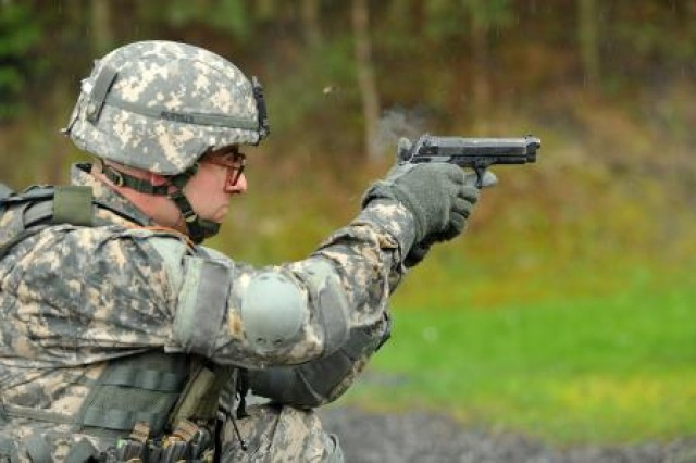 First Lt. Carl Hill, assigned to 1st Battalion, 4th Infantry Regiment, fires his M-9 pistol to zero during the Joint Multinational Training Command Best Officer Competition on Grafenwoehr Training Area, last month.