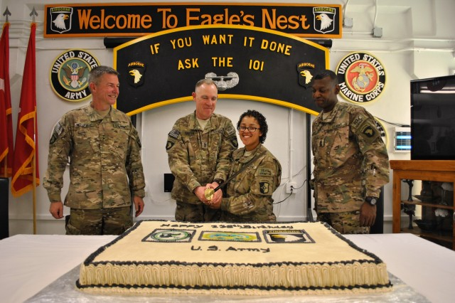 "PARWAN PROVINCE, Afghanistan "" U.S. Army Maj. Gen. James C. McConville (left), commanding general, Combined Joint Task Force - 101 and Regional Command East and native of Quincy, Mass., and U.S. Army Command Sgt. Maj. Alonzo J. Smith (right), command sergeant major, CJTF - 101 and RC-East and native of Fayetteville, N.C., look on as U.S. Army Sgt. Maj. Thomas Coulter, CJTF - 101 and RC-East CJ2 (Intelligence) sergeant major, and U.S. Army Pvt. Alice Harris, CJTF - 101 and RC-East CJ1 (Personnel) awards clerk, prepare to make the ceremonious first cut into a birthday cake, celebrating the U.S. Army's 238th birthday at Bagram Airfield, June 14, 2013. Coulter, 55, a native of Syracuse, N.Y., and Harris, 18, a native of Pinellas Park, Fla., the oldest and youngest Soldiers in the CJTF-101 headquarters, teamed up to cut the cake as part of a time-honored tradition representing the past and future of the Army. Today's celebration recognized the continued strength, professionalism, and bravery of our ready and resilient Soldiers in the all-volunteer force."