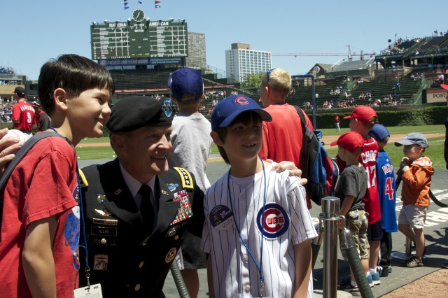 """Gen. Daniel B. Allyn, commanding general of U.S. Army Forces Command, poses with Chicago Cubs fans before the team's June 13, 2013 game at Wrigley Field against the Cincinnati Reds. Allyn encouraged the young fans to remember to sing """"Happy Birthday"""" to the U.S. Army on June 14, when it turns 238 years old. (U.S. Army photo by Dave Chace, FORSCOM Public Affairs)"""