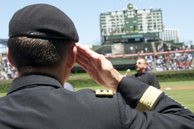 Gen. Daniel B. Allyn salutes the U.S. flag during the national anthem before a Chicago Cubs vs. Cincinnati Reds game June 13, 2013 at Wrigley Field in Chicago. Allyn, the commanding general of U.S. Army Forces Command out of Fort Bragg, N.C., threw out the game's first pitch. (U.S. Army photo by Dave Chace, FORSCOM Public Affairs)