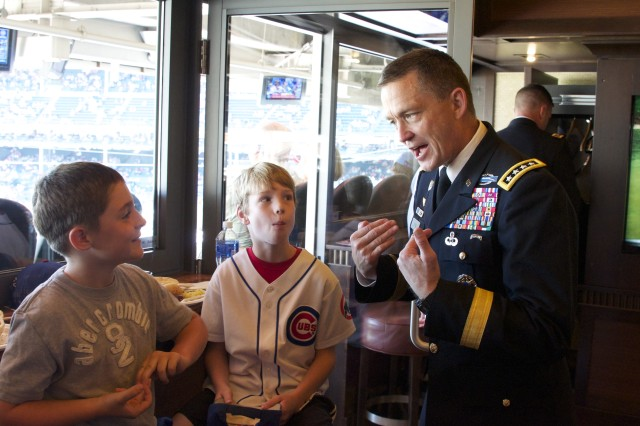 """""""No, I'm not turning 238 years old … the ARMY is turning 238!"""" explains Gen. Daniel B. Allyn to two young Chicago Cubs fans during the team's June 13, 2013 game against the Cincinnati Reds in Chicago. Allyn, the commanding general of U.S. Army Forces Command, visited the city to raise awareness of the Army's birthday on June 14 while highlighting Army programs to support veterans across the country. (U.S. Army photo by Dave Chace, FORSCOM Public Affairs)"""