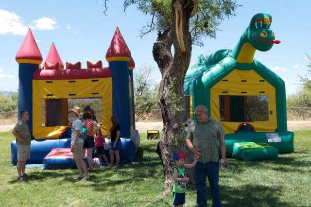 Organizers of the Company D, 2-13th Aviation Regiment Summer Kick-Off Safety Stand Down Day Picnic on June 7 at Veterans' Memorial Park held the event in a relaxed atmosphere away from work. Families were welcome. Here, children 12 and under enjoy bouncy castles set up for the afternoon.