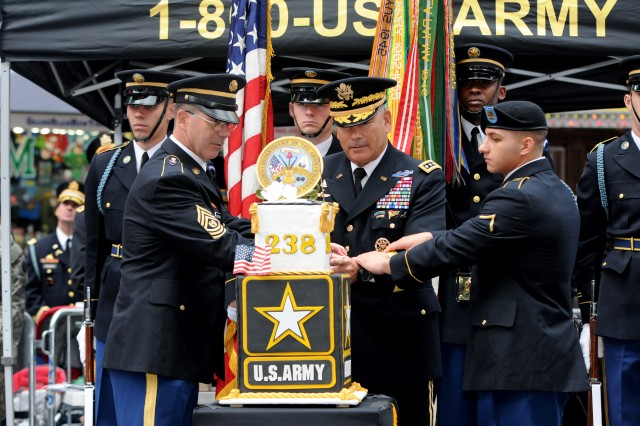 From left to right: Command Sgt. Maj. Cal Christensen, United States Military Academy Band, Gen. John Campbell, 34th Army Vice Chief of Staff, and Pvt. Justin Paradiso, infantryman, 69th Infantry Regiment, celebrate the 238th Army birthday during a cake cutting ceremony, June 14, in Times Square, New York City. (U.S. Army photo by Staff Sgt. Luisito Brooks)