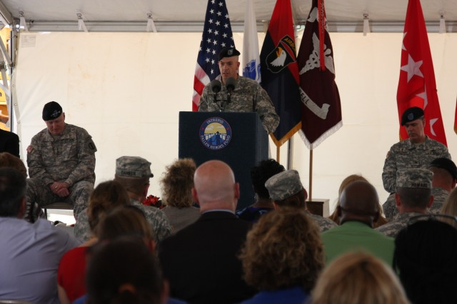 Staff Sgt. Todd Domerese shares his story of traumatic brain injury and road to healing at a groundbreaking ceremony June 13 at Fort Campbell, Ky. for the third in a series of nine National Intrepid Center of Excellence (NICoE) Satellite Centers designed to diagnose and treat traumatic brain injury and post-traumatic stress. Domerese explained how the TBI he received in combat dramatically changed his life and altered his behavior after returning home. The treatment Domerese received at the NICoE facility in Bethesda, Md. helped him regain psychological health. Domerese joined fellow Soldiers who have also received TBI treatment, military leaders, including Gen. Robert Cone, the Commanding General for the U.S. Army Training and Doctrine Command, Brig. Gen. Mark Stammer, the Senior Mission Commander for the 101st Airborne Division and Fort Campbell and Blanchfield Army Hospital Commander Col. Paul R. Cordts, as well as leaders from the Intrepid Fallen Heroes Fund at the groundbreaking ceremony.