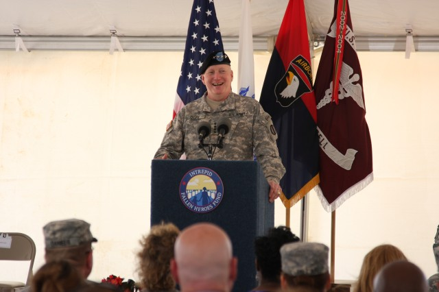 Gen. Robert Cone, the Commanding General for the U.S. Army Training and Doctrine Command speaks at a groundbreaking ceremony June 13 at Fort Campbell, Ky. for the third in a series of nine National Intrepid Center of Excellence (NICoE) Satellite Centers designed to diagnose and treat traumatic brain injury and post-traumatic stress. Cone told the crowd of more than 200 people that this groundbreaking not only helps Soldiers, but also speaks to the dedication of the American people to reaching out to care for our military. Cone joined Soldiers who have received TBI treatment, other military leaders, including Brig. Gen. Mark Stammer, the Senior Mission Commander for the 101st Airborne Division and Fort Campbell and Blanchfield Army Hospital Commander Col. Paul R. Cordts, as well as fellow leaders from the Intrepid Fallen Heroes Fund at the groundbreaking ceremony.