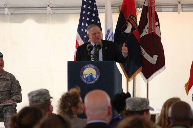 Retired Gen. Richard Cody, center, the former vice chief of staff of the Army and Intrepid Fallen Heroes Fund Trustee, speaks during a groundbreaking ceremony for the third in a series of nine National Intrepid Center of Excellence (NICoE) Satellite Centers, at Fort Campbell, Ky., June 13, 2013. The NICoE Satellite Centers are designed to diagnose and treat traumatic brain injury (TBI) and post-traumatic stress. Cody joined Soldiers who have received TBI treatment, and military leaders, Gen. Robert Cone, the commanding general of the U.S. Army Training and Doctrine Command; Brig. Gen. Mark Stammer, the senior mission commander for the 101st Airborne Division and Fort Campbell and Col. Paul R. Cordts, the commander of the Blanchfield Army Hospital, as well as fellow leaders from the Intrepid Fallen Heroes Fund during the ceremony.