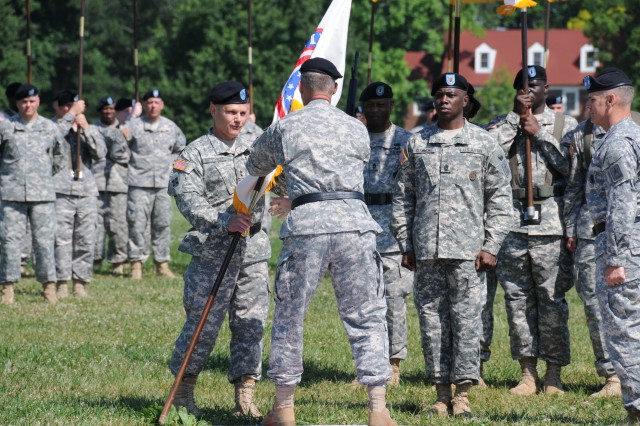 Army Training and Doctrine Command (TRADOC) Deputy Commanding General/Chief of Staff Lt. Gen. David Halverson passes the colors to Army Recruiting Command (USAREC) Commanding General Maj. Gen. Allen Batschelet during the change of command ceremony at Fort Knox, Ky., June 13.