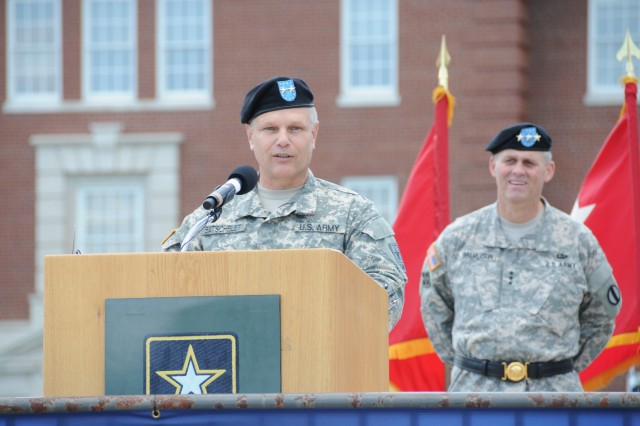 TRADOC Deputy Commanding General/Chief of Staff Lt. Gen. David Halverson looks on as USAREC Commanding General Maj. Gen. Allen Batschelet speaks to the crowd after taking command of USAREC during the change of command ceremony at Fort Knox, Ky., June 13.