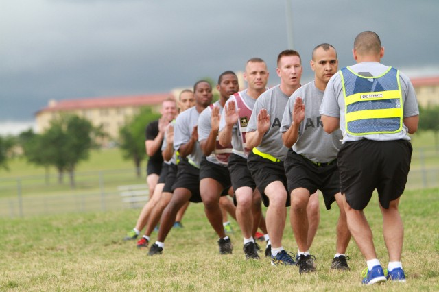 Soldiers in the Master Fitness Trainer Course step across Prichard Field June 5 as part of a warmup before physical readiness training. The warmup drill may seem like an extra step in the workout process, but getting the muscles properly prepped is actually keeping many Soldiers from injuries. The 30 Soldiers return to their units with a new understanding of sports science to pass on to Soldiers in their respective units.