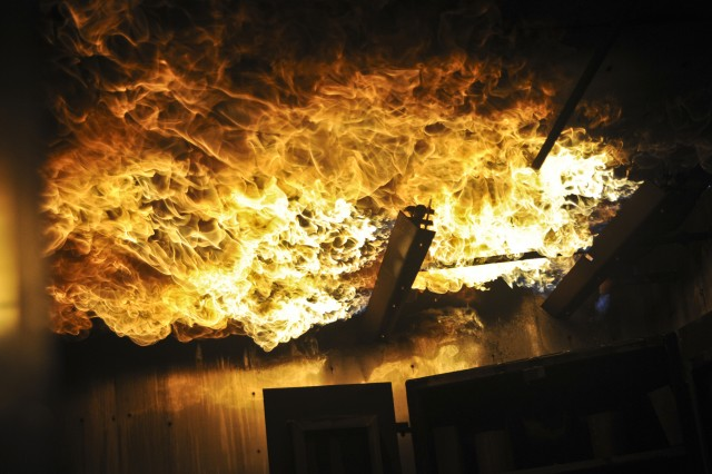 A propane fire plumes along the ceiling of a room during a controlled burn exercise held in Bedford, Mass., June 8, 2013. U.S Soldiers with the 287th, 339th, 356th, and 530th Engineer Firefighting Teams as well as the 468th Engineer Detachment Headquarters Company, participated in the training exercise.