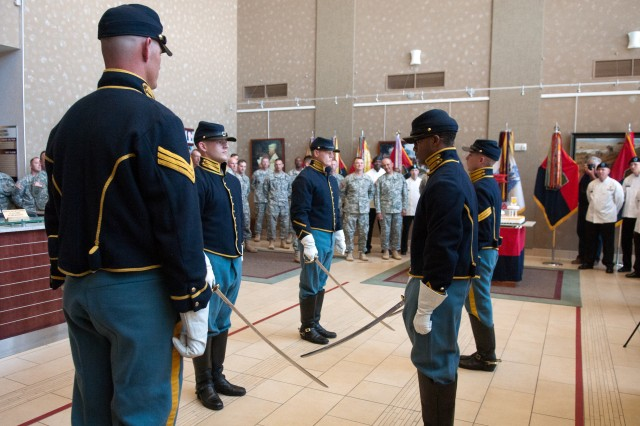 Sgt. Tommy Evans (foreground), Commanding General's Mounted Color Guard, leads a saber ceremony June 11 at division headquarters. The ceremony was a part of division's victory week honoring the Army and divisions birthday. The 1st Inf. Div. celebrated its 96th year on June 8, and the Army celebrated its 238th on June 14.