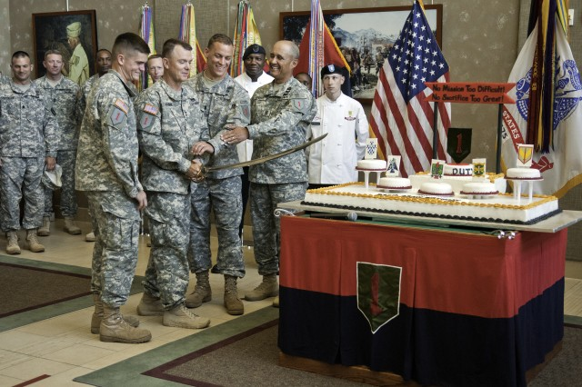 "First Lt. Samuel Gulland; Maj. Gen. Paul E. Funk II, 1st Infantry Division and Fort Riley commanding general; 1st Lt. Christopher Siok; and Command Sgt. Maj. Miguel Rivera prepare to cut the Army and 1st Infantry Division's birthday cake June 11 at division headquarters. The division turned 96 on June 8, and the Army turned 238 on June 14. Gulland and Siok, from 1st Battalion, 28th Infantry Regiment, 4th Infantry Brigade Combat Team, represented the 1st Inf. Div. at the most recent Best Ranger Competition, placing 13th "" the highest of any division team. The cake cutting was part of the division's annual Victory Week celebration, which honors current and former brave, responsible and on point Big Red One Soldiers."