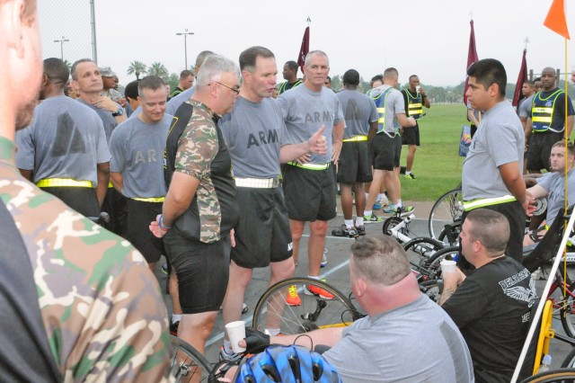 FORT SAM HOUSTON, Texas - Maj. Gen. Perry Wiggins (center) and Command Sgt. Maj. Hu Rhodes say thank you to the wounded warriors who participated in the 'Thunder Run' June 14 as part of the celebration of the Army's 238th Birthday. Wiggins is the deputy commanding general for operations, U.S. Army North (Fifth Army), and Rhodes is the senior enlisted leader for Army North, Fort Sam Houston and Camp Bullis.