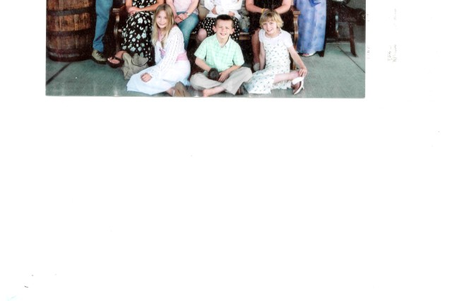 """Victor Taylor, safety chief for the U.S. Army Corps of Engineers """" Huntsville Center, is the proud father of 12 children, ranging in age from 15 to 38. Front row, left to right: Derica, Thatcher and Danica. Second row: Dosha, Donia, Dara and Disa. Third row: Taylor, Tevis, Thomas, Timon, Tyce, Titus and wife Pam."""