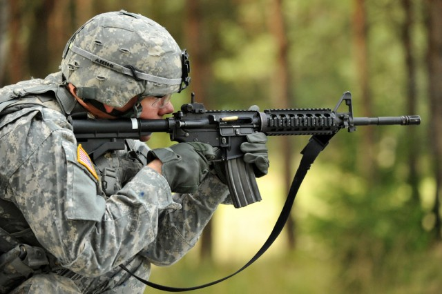Spc. Ethan Esposito, Joint Multinational Training Command, fires his M4 carbine rifle during United States Army Europe's Best Warrior Competition in Grafenwoehr, Germany, July 31, 2012.  The Army has been, since 2008, looking for a follow-on weapon for the M4 carbine.  In 2011, it began the Individual Carbine competition. Recently, the service concluded the competition without having chosen a winner.