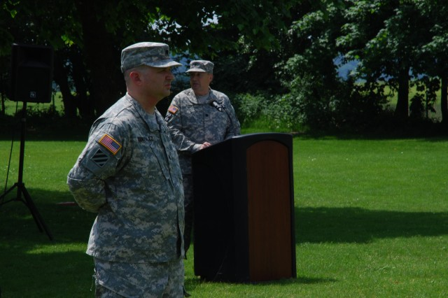 Incoming commander Lt. Col. Rodney S. Gonzalez, left, stands in front of the formation while outgoing commander, Lt. Col. Raymond L. Gundry, gives his farewell speech at a change of command ceremony in Katterbach, Germany, June. 13.