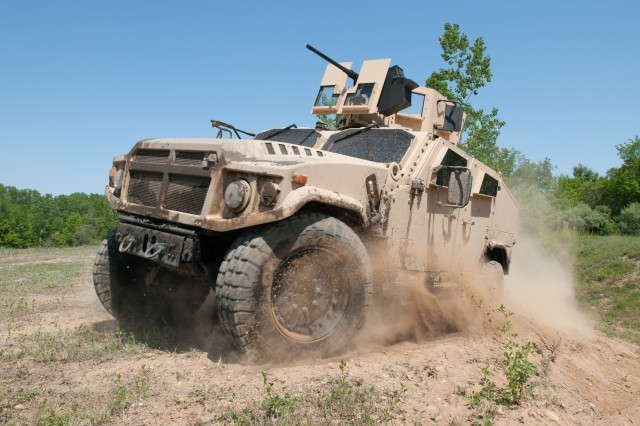 AM General's Joint Light Tactical Vehicle prototype negotiates the off-road demonstration course at the Transportation Demonstration Support Area in Quantico, Va.