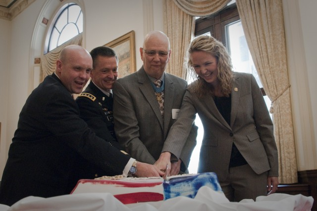 """Gen. Daniel B. Allyn (second from left) cuts a U.S. Army birthday cake alongside Chicago community leaders and """"Soldier for Life"""" panel members June 14, 2013 in Chicago. Allyn participated in several community events, emphasizing programs supporting veterans as well as the values and benefits veterans bring to civilian communities. (U.S. Army photo by Dave Chace, FORSCOM Public Affairs)"""