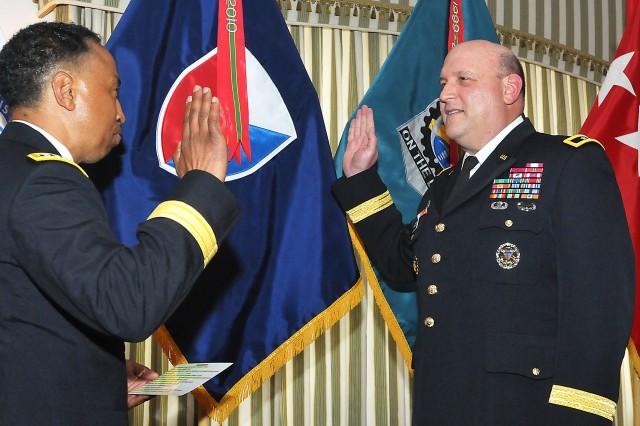 Gen. Dennis Via, commanding general of AMC, administers the oath of office to Maj. Gen. John Wharton, ASC commanding general. (Photo by Jon Micheal Connor, ASC Public Affairs)