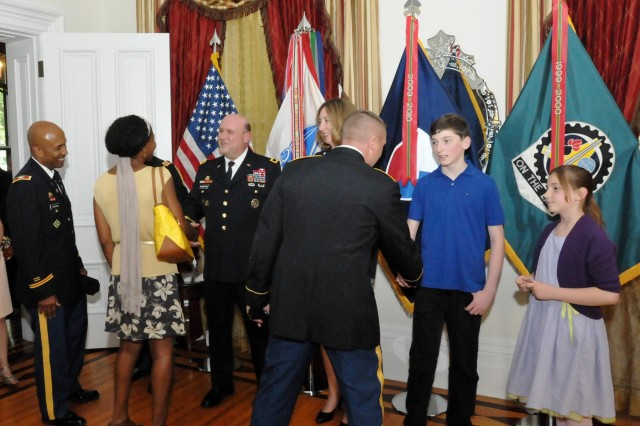 The Wharton family receives congratulations from well-wishers who attended the ceremony at the Rock Island Arsenal Golf Club. This receiving line was held inside the historic Quarters One at RIA. (Photo by Jon Micheal Connor, ASC Public Affairs)