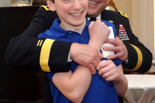 Maj. Gen. John Wharton and his son, John Paul, enjoy spending time together in Quarters One where a reception was held for ceremony attendees. (Photo by Liz Adolphi, ASC Public Affairs)