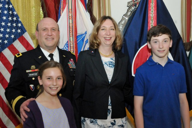 The family of newly promoted Maj. Gen. John Wharton gather during the reception at Quarters One following the promotion ceremony on June 13. (Photo by Jon Micheal Connor, ASC Public Affairs)