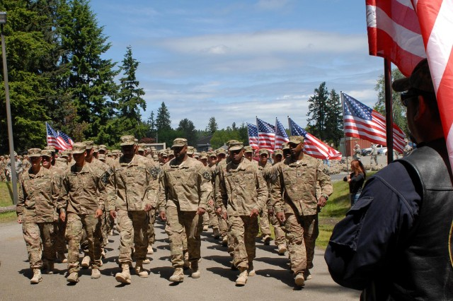 Soldiers from 4th Stryker Brigade Combat Team, 2nd Infantry Division, march in formation to the welcome back ceremony held at Soldiers Field House, Joint Base Lewis-McChord, Wash., upon return from their seven-month deployment to Afghanistan in support of Operation Enduring Freedom, June 1.