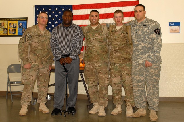 Sgt. Anthony Dekargai (second from left), is seen with Sgt. 1st Class Tyson McElhaney (left), Spc. William Stankus (center), Spc. Richard Ross (second from right), and Sgt. Douglas Derepentigny (right) at the troop-holding area on McChord Field, Joint Base Lewis-McChord, Wash., after greeting soldiers returning from deployment to Afghanistan in support of Operation Enduring Freedom, June 1.