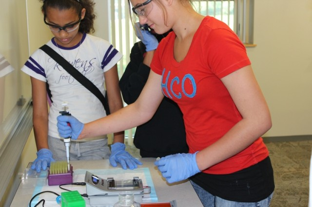 Edgewood Middle School students conduct gel electrophoresis during an ECBC hands-on STEM experience called 'Fascination DNA' at Project DREAM Work's Girls STEM Discovery Day.
