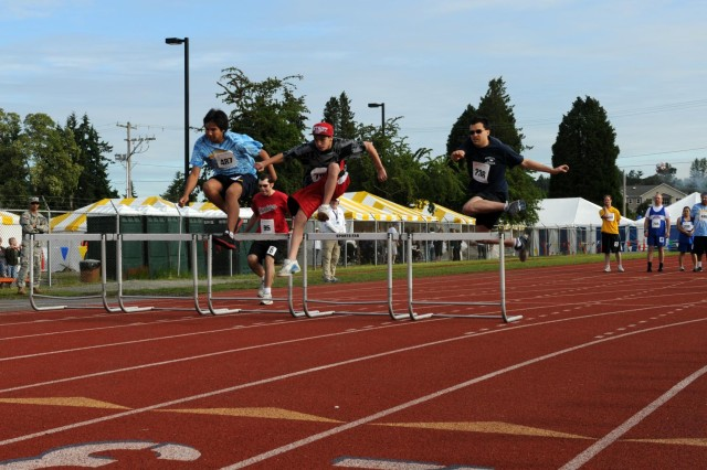 Special Olympians leap over the first set of hurdles during the 110-meter hurdle event at the 2013 Summer Games held at Joint Base Lewis-McChord, Wash., June 1, 2013.