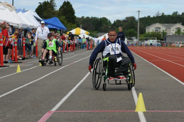 Dariece Steele, competing out of Olympia, Wash., comes in first during a wheelchair slalom race at the 2013 Special Olympics Summer Games at Joint Base Lewis-McChord, Wash., June 1, 2013. Athletes from all over the state of Washington traveled to compete at JBLM, which has been primary competition site for the Washington Special Olympics for four decades.