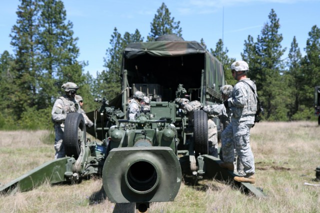 Soldiers with 1st Battalion (155mm Towed), 377th Field Artillery Regiment, 17th Fires Brigade, set up an M777A2 howitzer during a best section competition May 1, 2013. Artillerymen with 1st Section, 1st Platoon, C Battery, 1-377FA won the nearly two-week competition. (U.S. Army photo by Sgt. Justin Naylor, 17th Public Affairs Detachment /Released)